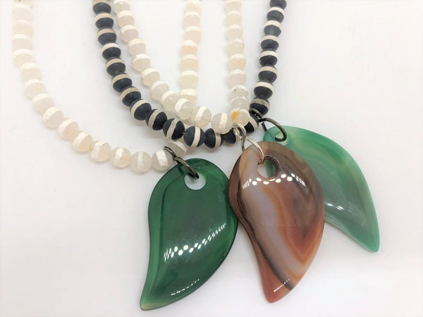 Hand painted striped agate beads white or black with an agate leaf pendant