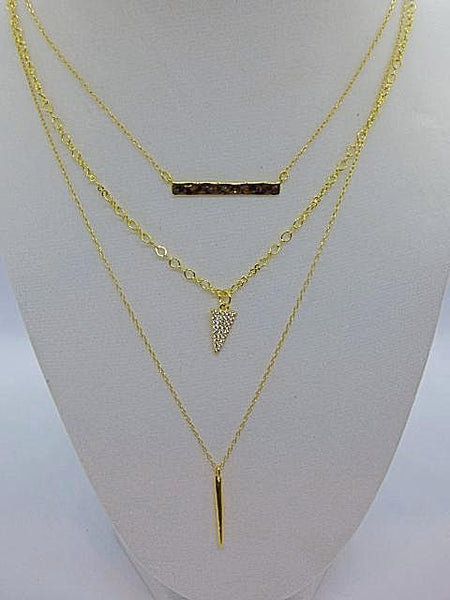 3 silver or gold layered necklaces with a dagger, rhinestone triangle or hammered bar