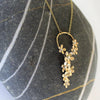 'daisy chain' golden daisy chain pendant