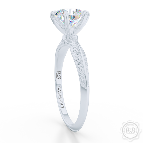 Classic knife-edge, Six-Prong Round Solitaire Engagement Ring. Crafted in White Gold or Precious Platinum. Elegantly hand-engraved shoulders. FOREVER ONE Round Brilliant Moissanite. Free Shipping USA. 30-Day Returns | BASHERT JEWELRY | Boca Raton, Florida
