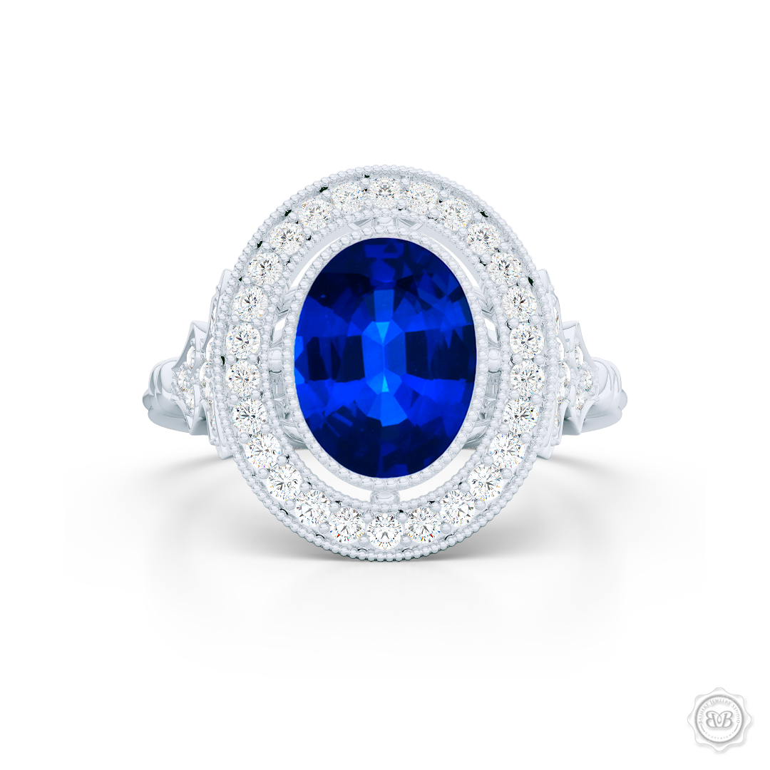 Floating Oval Halo Engagement Ring. Vintage inspired lines, handcrafted in Precious Platinum or White  Gold. Oval Royal Blue Sapphire. Halo and shoulders finished in classic french milgrain, bringing a refine art-deco silhouette to this design.  Free Shipping on All USA Orders. 30-Day Returns | BASHERT JEWELRY | Boca Raton, Florida