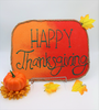 This Happy Thanksgiving sand art was created with Scenic Sand colored sand and a blank adhesive board for sand art.