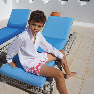Childrens Linen Shirt: WHITE sitting on a sunbed Mustique