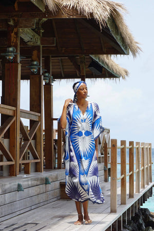 Lotty B Long Kaftan in Cotton: FAN PALM - BLUE Standing on the deck at Basil's Mustique