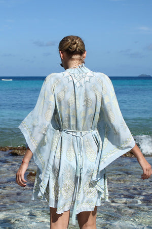 Lotty B Short Kaftan in Silk Crepe-de-Chine: PINEAPPLE - OLIVE back looking at the sea