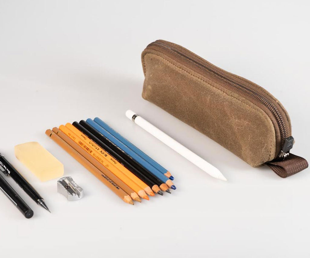 Holds assorted writing implements