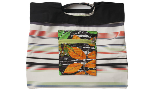 Pastel stripes and vibrant orange and green amazon jungle pattern zipper pocket. Reversible upcycled cotton ladies eco bag with zipper pocket. Sustainable, ethical on the go essentials for beach or city. Empowers women in Brazilian slums.