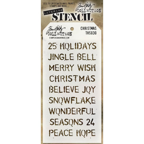 Christmas Stencil from Tim Holtz. Sayings and words include (in uppercase or all capital letters) : 25, Holidays, Jingle Bells, Merry, Wish, Christmas, Believe, Joy, Snowflake, Wonderful, Seasons, 24, Peace, Joy.