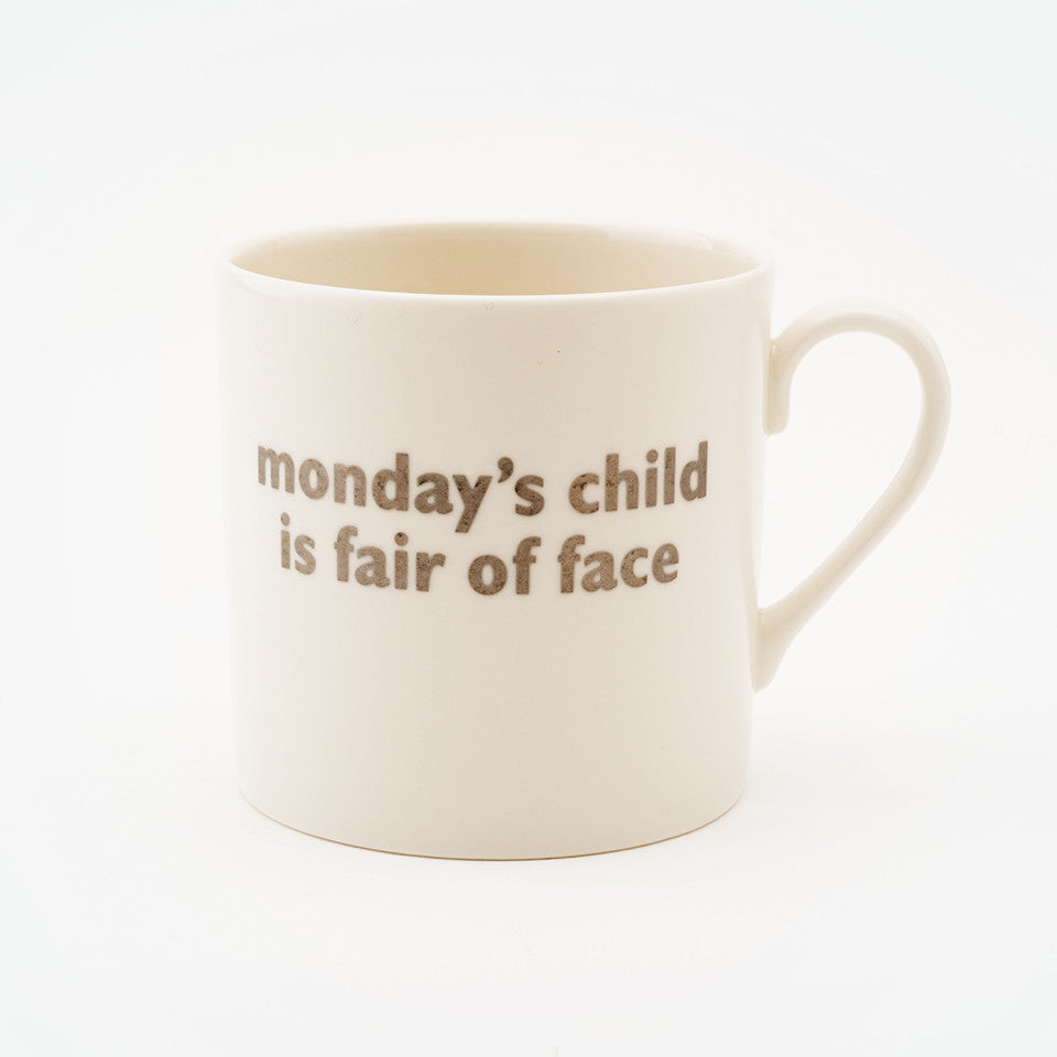 Monday's child, children's mug with platinum text.