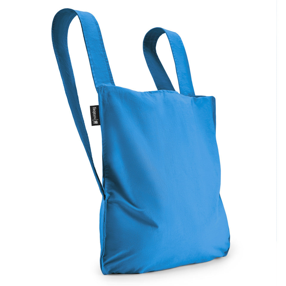 Not-a-bag re-usable fold-away pouch, blue, shown as backpack.