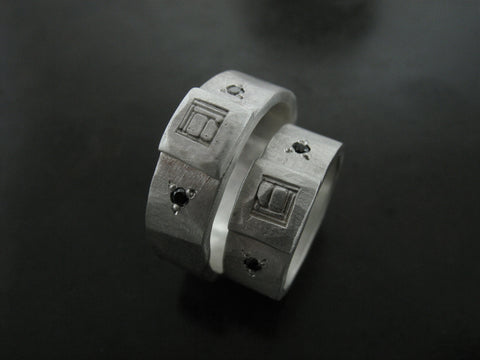 Erica and Julian's Custom Logo Rings
