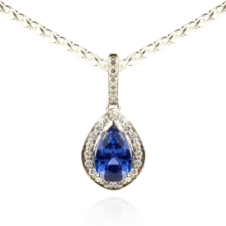 An 18ct white gold Blue Sapphire and Diamond pendant