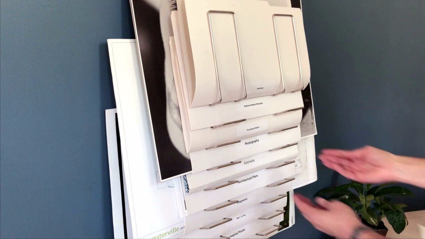wall mount file rack, the Up Filer. See how it works. Made of wood & nickel plated steel with 10 pockets or slots for organizing, papers, documents, files, drawings, plans, blueprints, art, prints, etc.