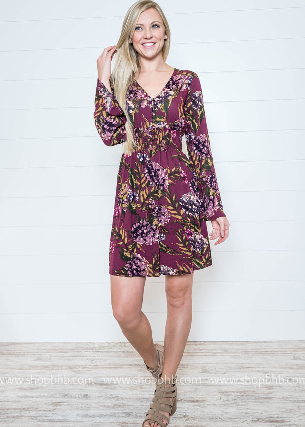 Loving this plum floral dress with it's v-neck and button up details.