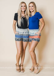 coral blue printed colorblock shorts with pockets