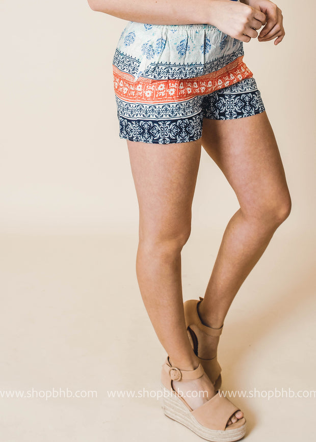 coral printed colorblock shorts with pockets