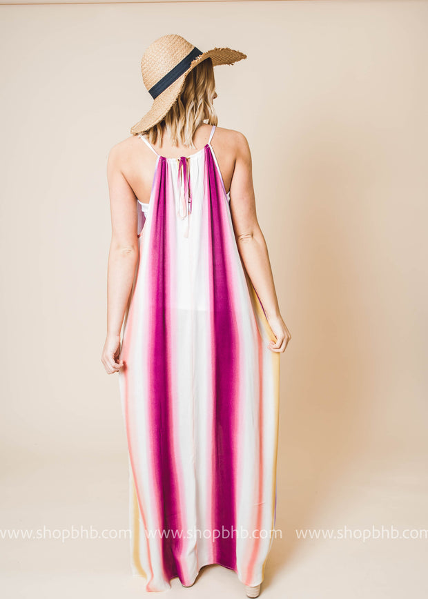 striped halter top dress features a column silhouette and pockets.