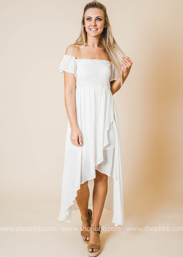 Ivory maxi dress features an elastic ruching bust , high-low ruffled hem and cinched waist.