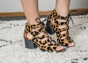Leopard print lace up sandel with wide cutout straps and block heel