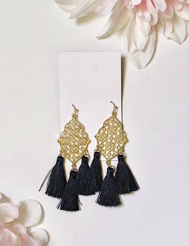 gold earring with black fringe