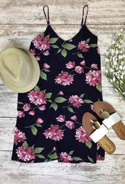 This navy floral dress is ready to hit the vacation destination or those spring occasions.
