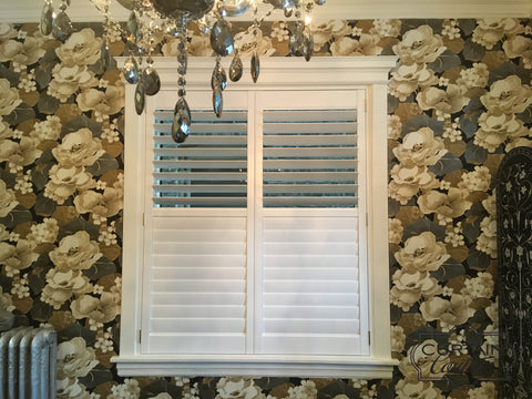 Hunter Douglas NewStyle shutters compliments elegantly with the beautiful floral wallpaper. Designed by Curtain Couture.