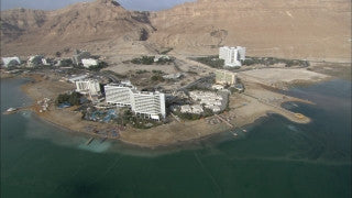 AD_003E Aerial helicopter footage of the Dead Sea: Dead Sea hotels, south to north