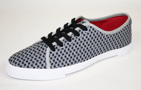 Premium canvas ladies sneaker with unique hashtag pattern.