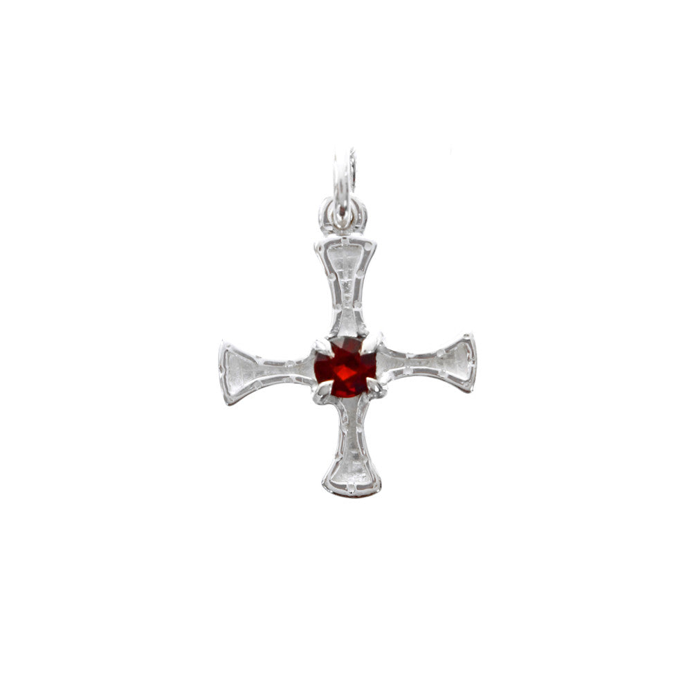 silver St. Cuthbert charm with garnet