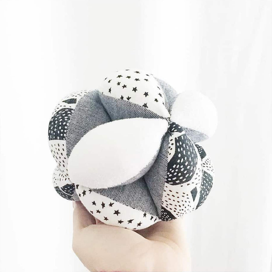 Wee Gallery - Organic Sensory Puzzle Ball - Bella Luna Toys - Hand Holding Ball