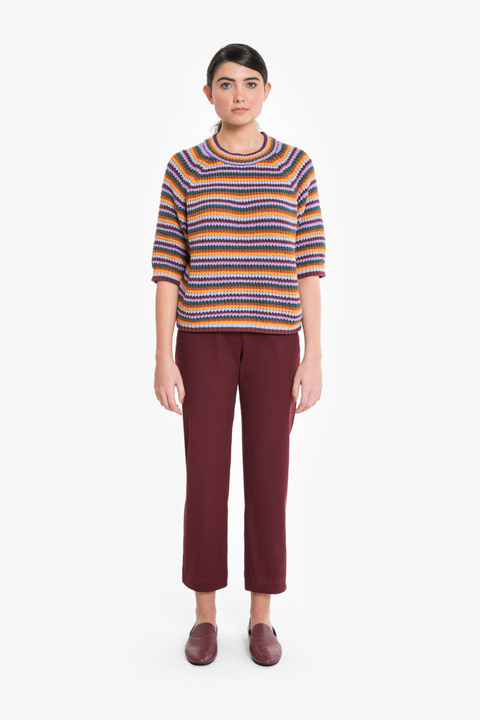 A chunky knit cotton jumper with three quarter sleeves and rainbow stripe