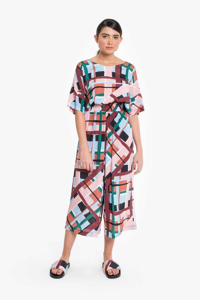 A cropped wide-leg jumpsuit in an oversized check. Made from Viscose
