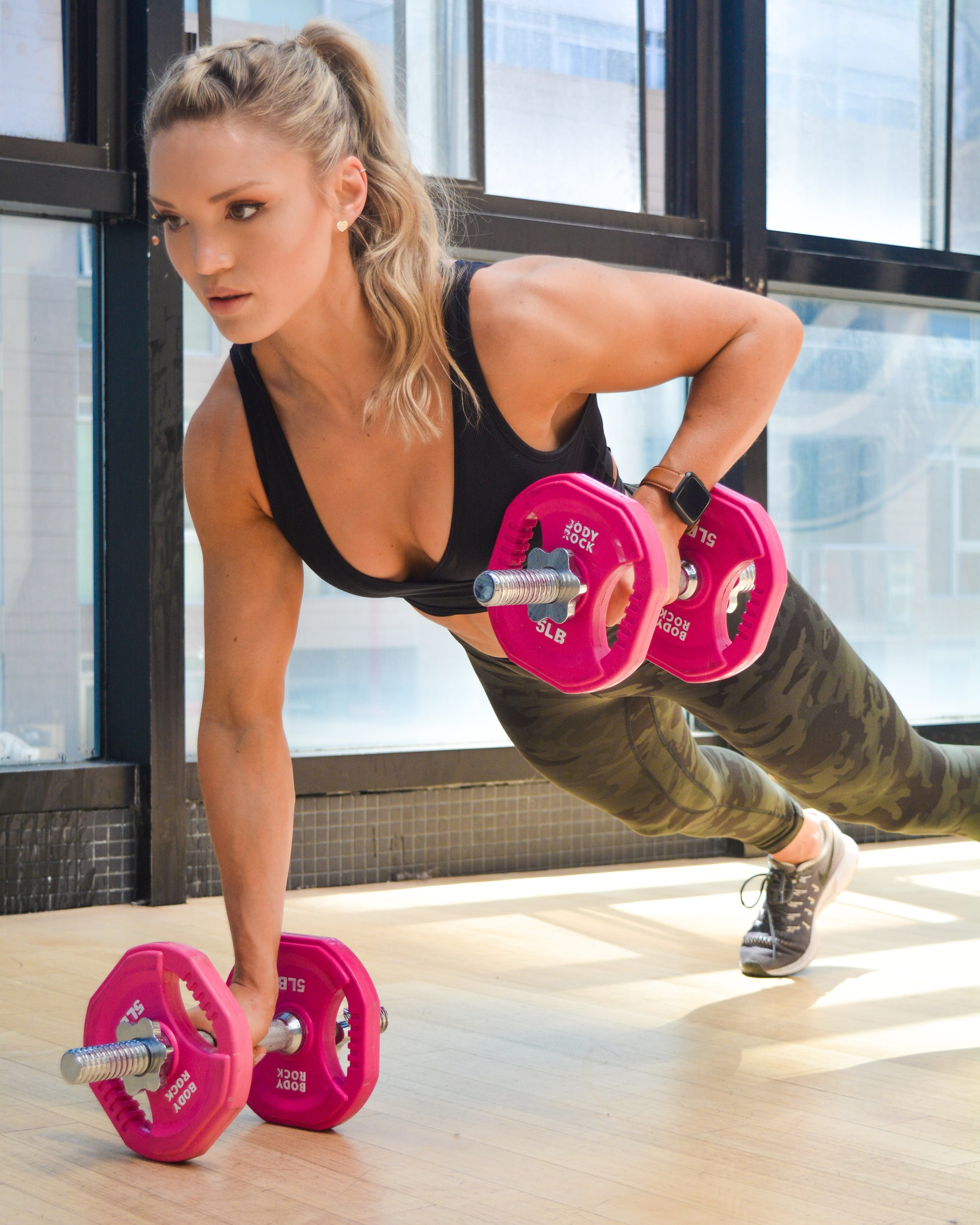 Image of Bodyrock host doing dumbbell pushups using bodyrock adjustable dumbbells