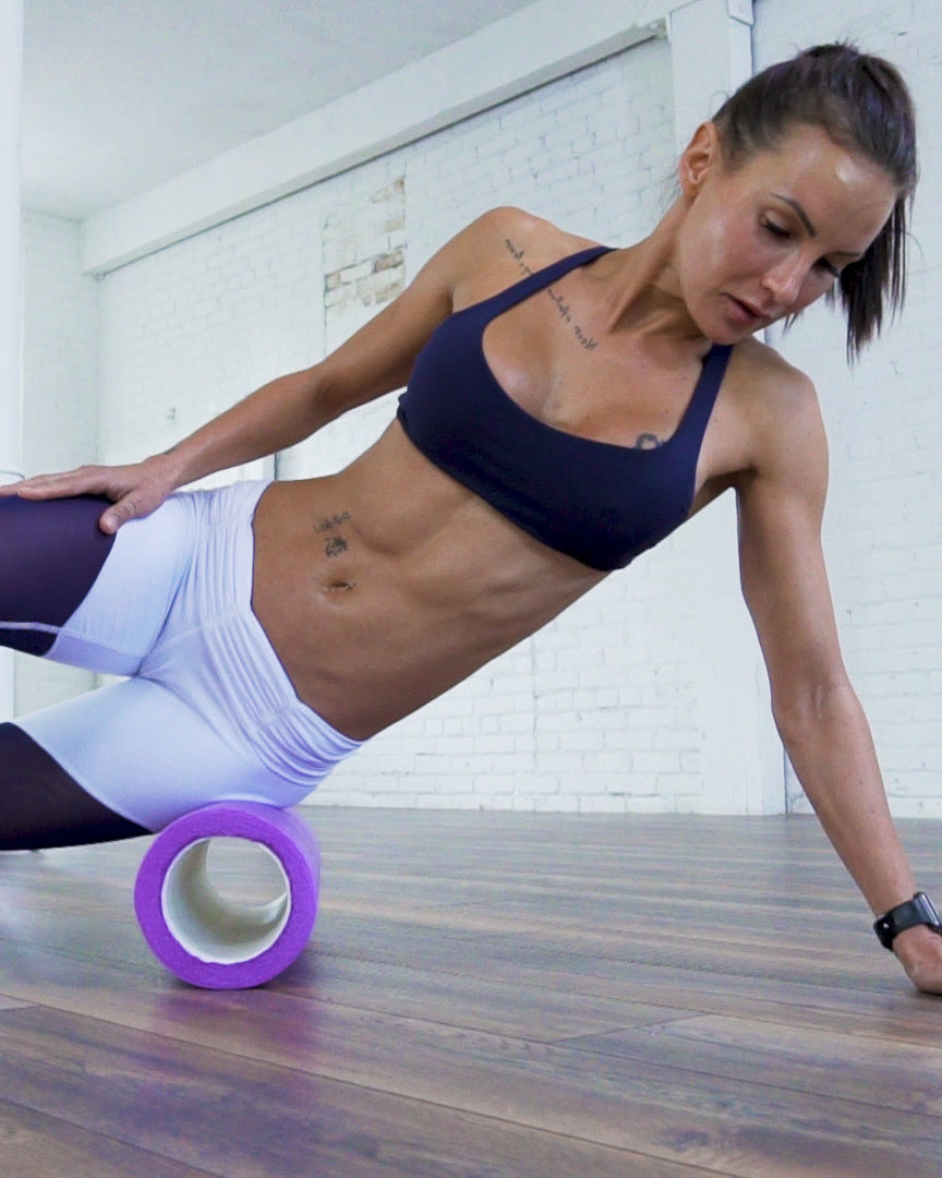 Image of Bodyrock Host Lisa using Bodyrock 3 in 1 foam roller on home floor
