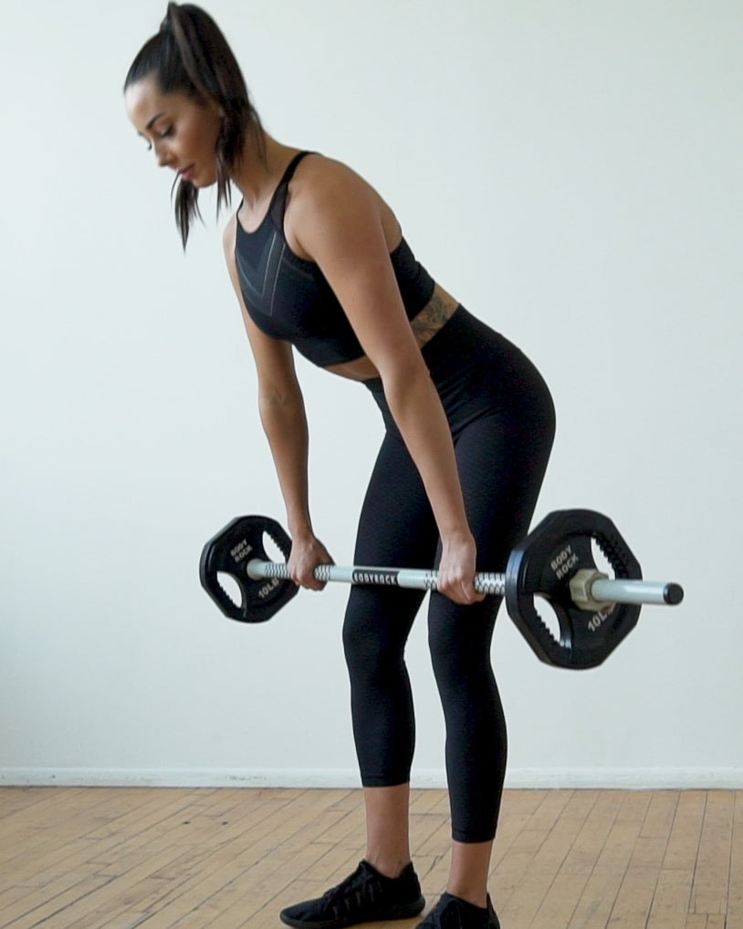 Image of Bodyrock Host lifting a Bodyrock Sculpt Barbell with weights showing dead lift