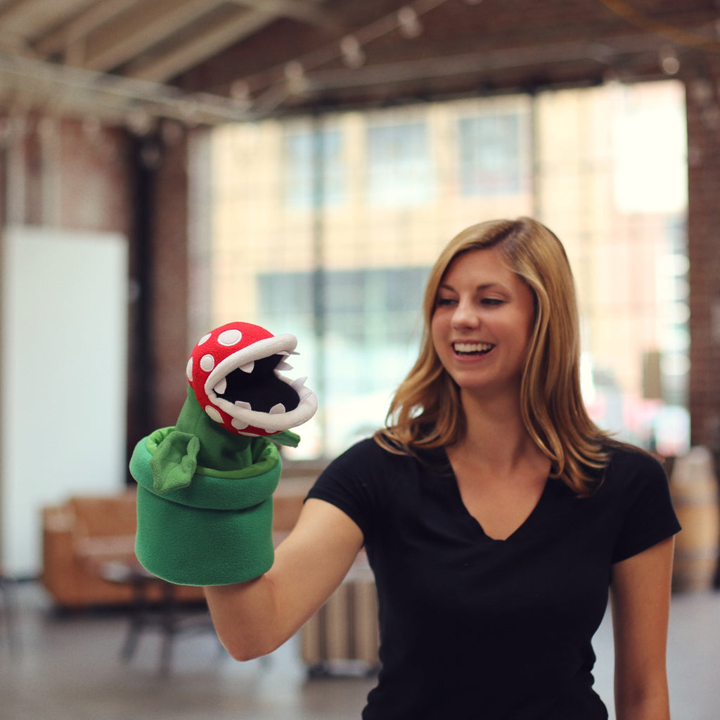 Piranha Plant puppet with a model