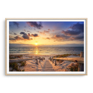Beautiful golden sunset at North Beach in Perth, Western Australia framed in raw oak