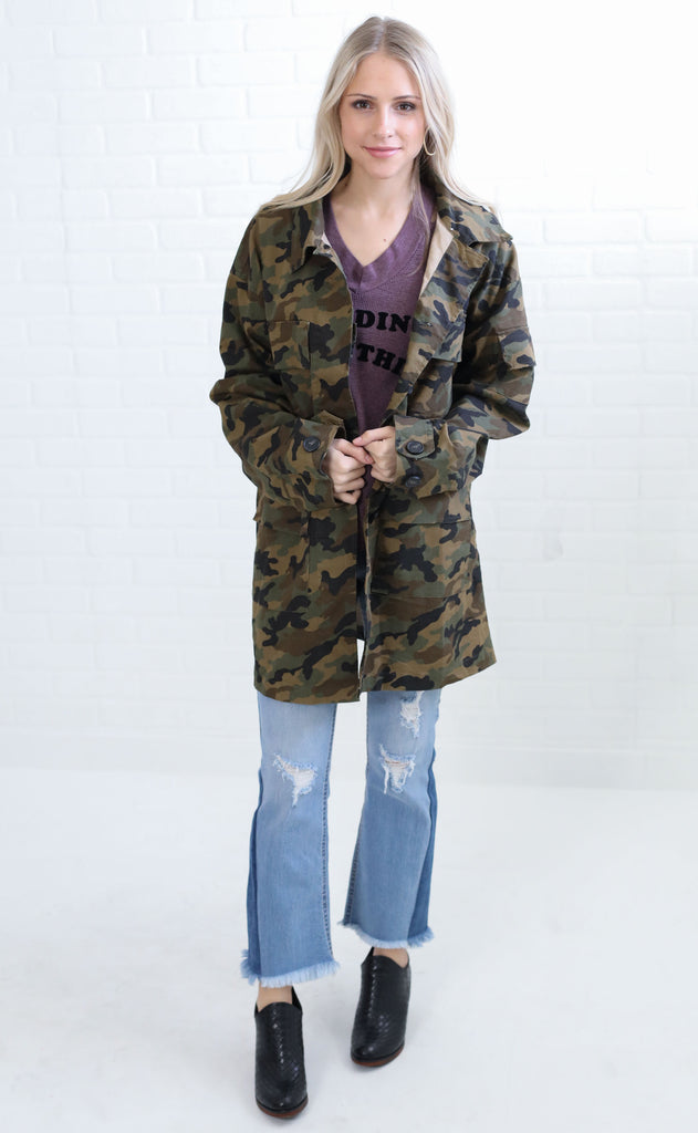 in disguise camo jacket