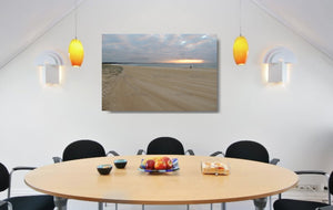 An acrylic print of a fisherman at sunrise at Blacksmiths Beach NSW hanging in a dining room setting