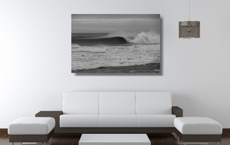 Photograph of a large and perfect wave breaking at Sandon Point NSW