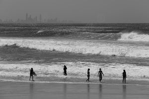 Black and white photograph of waves, people and buildings at Kirra Beach on the Gold Coast, QLD