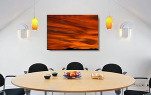 An acrylic print of a lunar landscape type sunset at Paradise Point QLD in hanging in a dining room setting