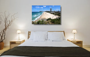 An acrylic print of North Burleigh Beach in QLD hanging in a bed room setting