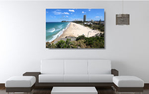 An acrylic print of North Burleigh Beach in QLD hanging in a lounge room setting