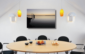 An acrylic print of sunset at Dunwich Jetty on North Stradbroke Island QLD hanging in a dining room setting