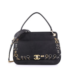 Chanel Model: Piercing Chic Flap Bag Grommet Embellished Caviar with Chain Detail Medium Black 40799/13