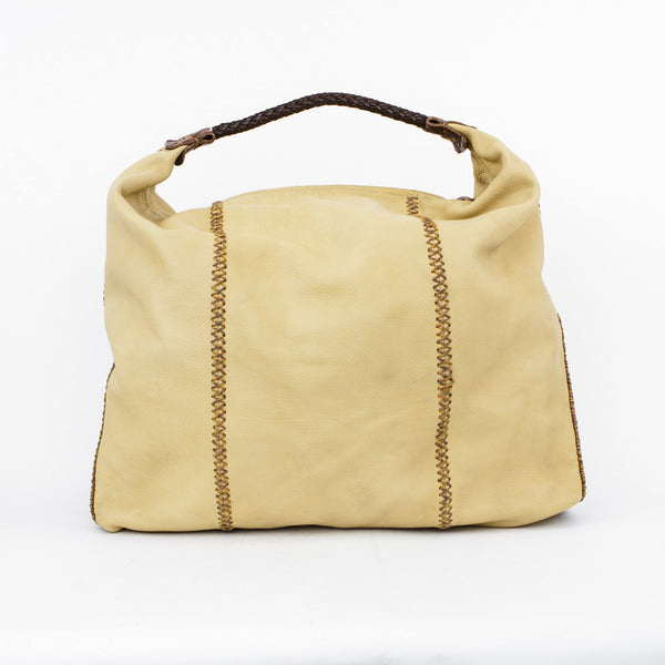 Beige leather tote from Falchi with brown leather branded handles, brown alligator embossed leather sides, and multi color accent cross stitching.
