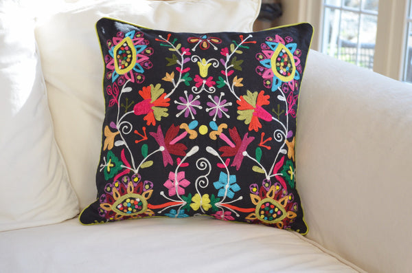 Decorative Pillows | Embroidered throw pillow with black and bright colors on sofa