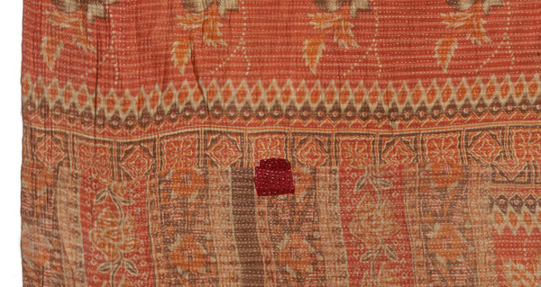 "Pattern detail of Vintage Kantha. Three panels of cotton (oftentimes from saris) are hand-stitched together with fine ""kantha"" stitches to create this one-of-a-kind find. Made in Jaipur, India, we love the warm earth tones and deft mix of pattern on this quilt."