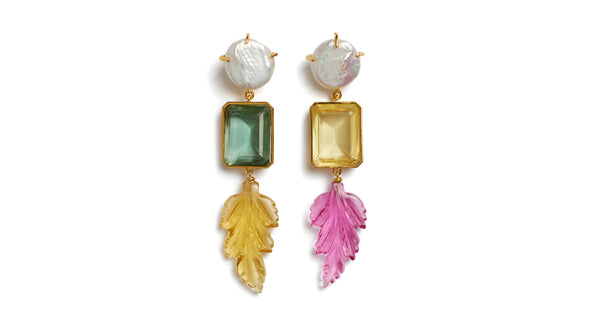 Full view of Joyride Earrings. Take these beauties out for a spin and be prepared for compliments. Asymmetric multicolored column earrings with baroque pearl tops, faceted quartz baguettes, and carved leaf charms in lemon topaz and rubelite quartz.